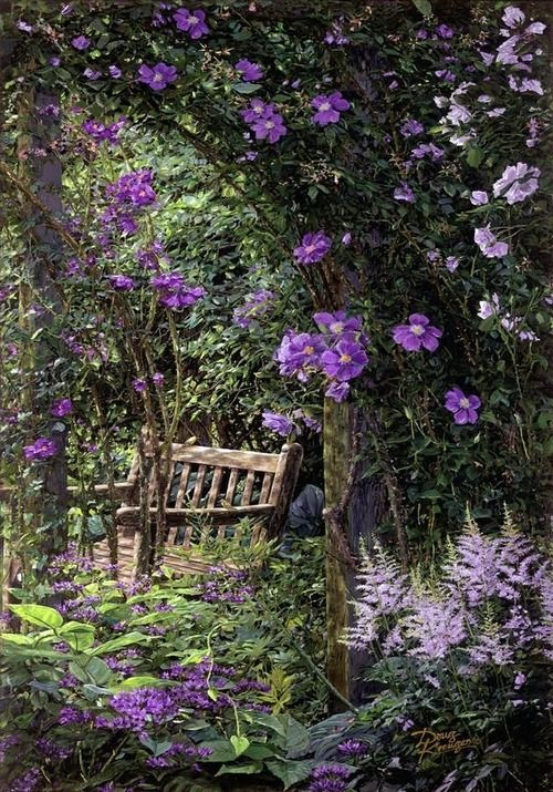 Beauiful garden bench surounded by lavender flowers and vines