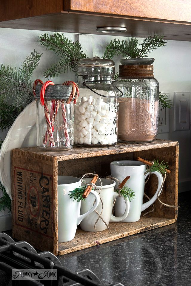 Rustic Christmas Hot Chocolate Bar, made with an old wooden box, mugs, and greenery.