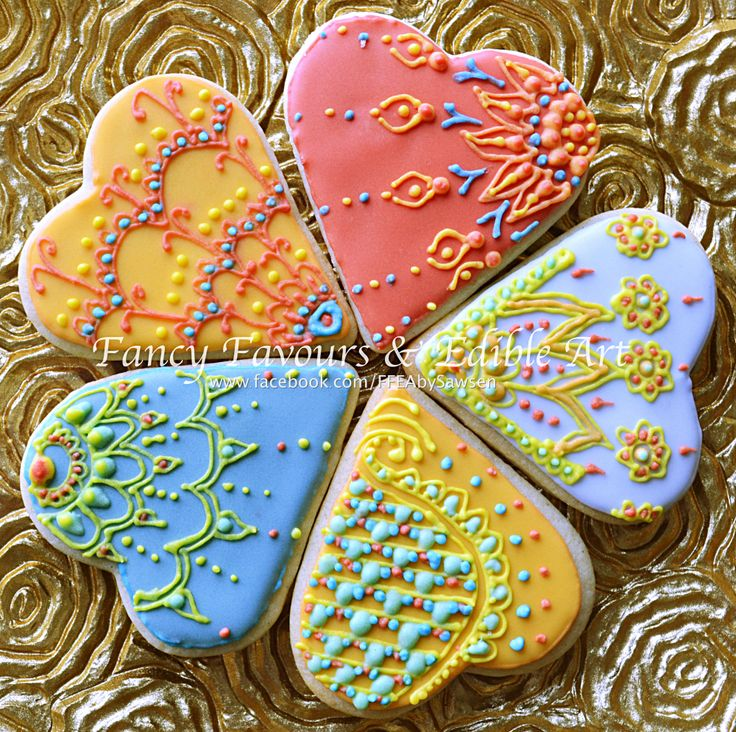 iced henna heart cookies | Fancy Favours & Edible Art -- #bright #henna #heart #engagement #indian #asian #piped #cookie #cookies #royalicing #rainbow #treats #favours #weddingfavours #wedding #handmade #edibleart