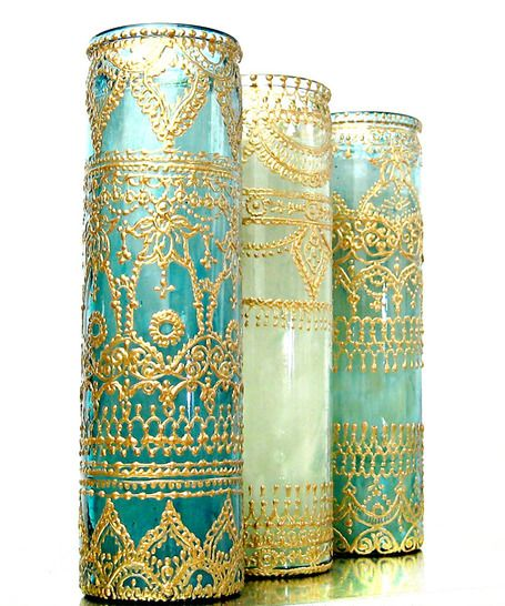 Candles with gold henna-style designs. Love the Moroccan feel. These are sold out and really expensive, but click through for a DIY version.: