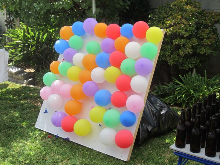 prizesfavors listed on paper inside ballons carnival game ideas 3 - Outdoor Party Decoration Ideas