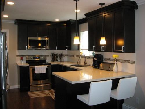 maple cabinets in a dark espresso stain an offwhite