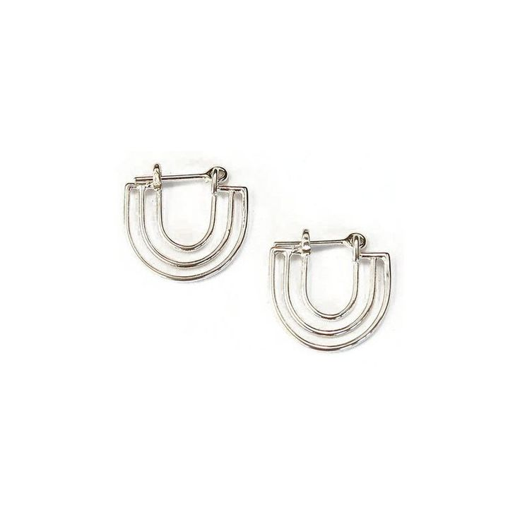 Concentric arches sized to perfectly hug the ear. MATERIAL Sterling Silver…