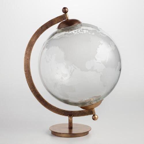 Crafted of mouth-blown glass that's hand-etched and supported by a brass stand, every one of our luminous globes is completely unique. Look closely at the decorative depiction of the continents and you'll detect the slight variations in etching and glass thickness that give each its own special character.