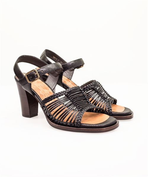 This saucy strappy sandal in black leather with plaited accents would make a great dancing shoe. On a high wooden stacked heel with adjustable ankle strap. Made in Spain.