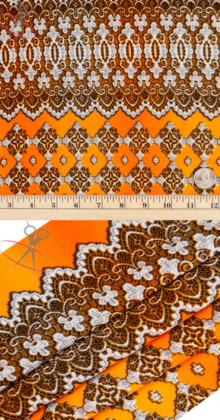 This print is bordered on both sides by a thick Mocha Brown Fleur de Lis design. In between these eloquent borders is a lattice quatrefoil pattern. The designs are made with a Mocha Brown and Off White, and are on top of an Orange Peach Skin background.