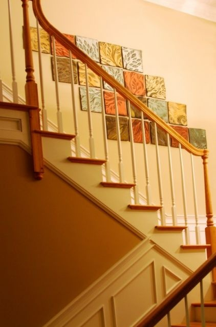I have been looking for ideas for the wall along my staircase. It's a two story foyer so it's a big empty space.  These are tiles but I could easily buy pre-stretched canvasses from Michael's and paint as many of them as I need! CHEAP!