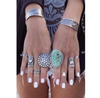 Great looking nails with cute rings