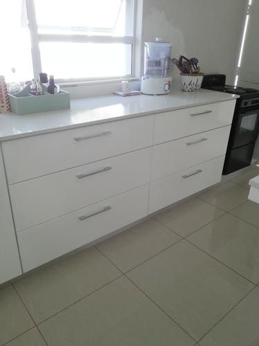The kitchen was completely gutted, painted & tiled by the owner. New counters, counter tops & cupboards designed, fabricated and installed by Dzines & Rekopane Creations. At the time of taking the photo the kitchen was being renovated.