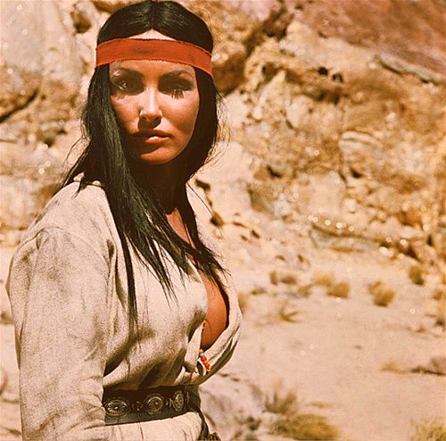 MACKENNA'S GOLD (1967) - Julie Newmar portrays a scar-faced Apache woman who rides with Omar Shariff's outlaw gang - Columbia Pictures - Publicity Still.