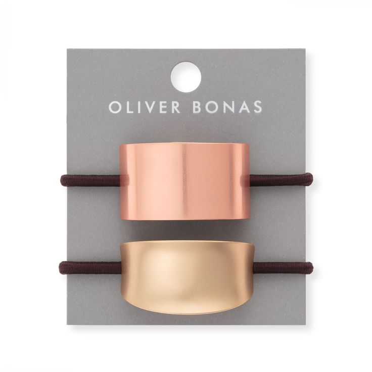 Buy the Set of Two Metallic Hair Bobbles at Oliver Bonas. Enjoy free worldwide standard delivery for orders over £50.