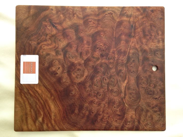 Camphor burl wood cutting board:  33 cm x 28cm x 1cm