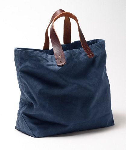 Waxed-Canvas Tote: BAGS | Free Shipping at L.L.Bean With a single patch pocket inside, this thing costs $99. Belt leather straps, riveted. Waxed canvas. Make.
