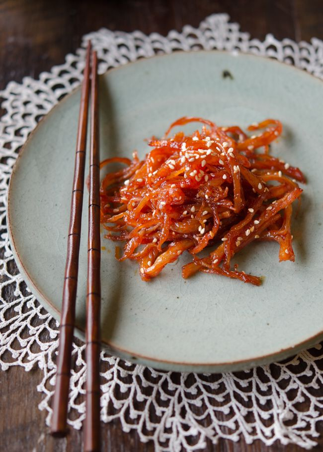 One of the popular Korean side dish made with dried and shredded squid. slightly spicy and sweet, this will make a wonderful side dish to serve with rice.