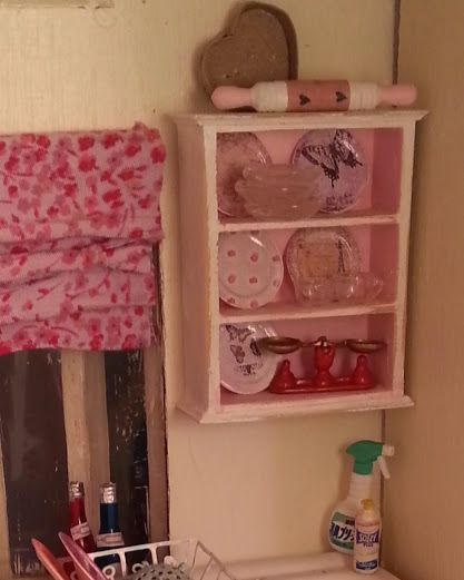 I had fun giving this little shelf unit a new look and filling it