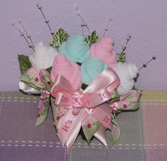 Baby Sock Corsages for Baby Showers...A Wonderful addition for the New Mommy and Daddy to be, Grandparents, Great-Grandmother or God Parent! They are perfect for just about anyone you wish to honor! Baby Sock Corsages: $10--Boutonniere (Pin On) $13--Two Bud Corsage (Pin On)
