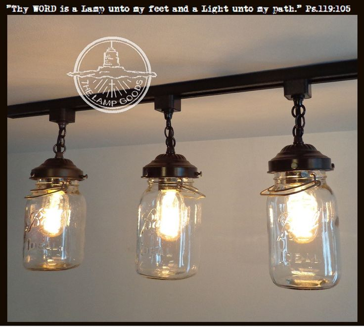 "An exclusive Mason Jar Track Lighting from Lamp Goods illuminating beautiful, vintage mason jars harvested from barns and farmhouse cupboards. * 42"" In-line Track System with Mounting Hardware * (3) B"