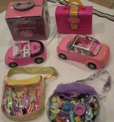 Polly Pocket! Oh, why did they change them to the horrible new design???? Why???  I had all of these!!!