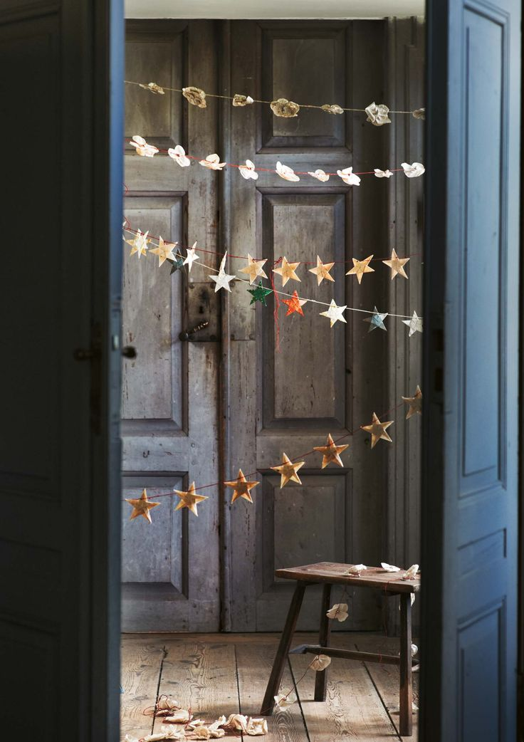 Big doors. Paper star garland by Toast
