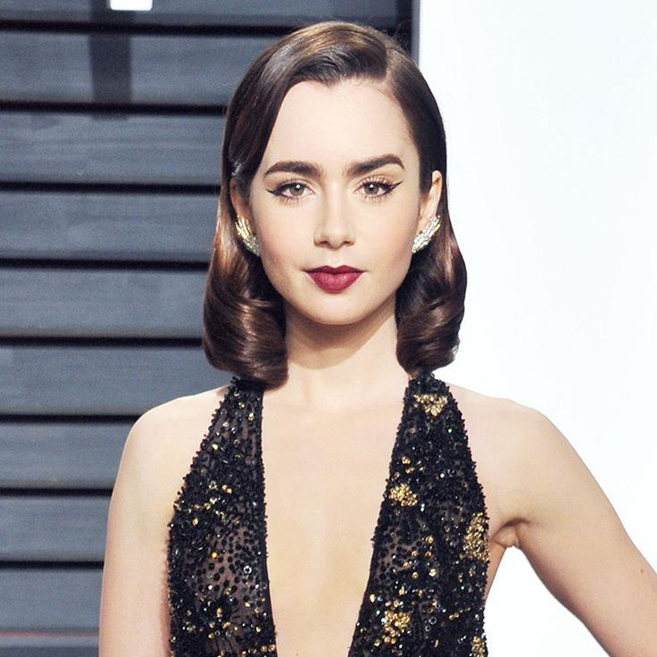 Retro Waves - She traded in her natural beach waves for more glamorous, Old Hollywood–inspired twists.