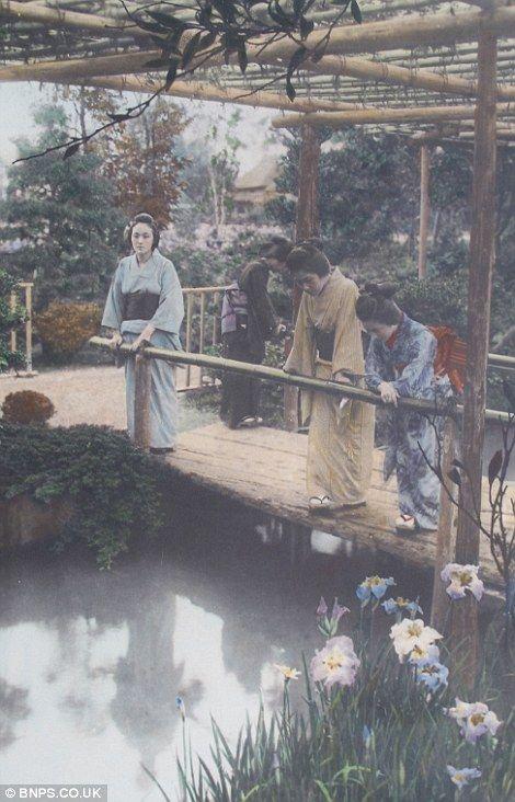 Geisha's look at their reflections in a landscaped garden pond, 1910 by Tamamura Kozaburo