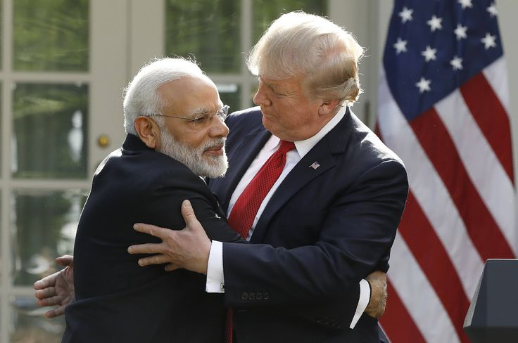 Has Donald Trump's awkward handshake met its match? https://tmbw.news/has-donald-trumps-awkward-handshake-met-its-match  When Indian Prime Minister Narendra Modi met with U.S. PresidentDonald Trump on Monday, he briefly shook his hand—then went right in for his signature bear hug, surprising the Trump with what seemed to be a pre-emptive embrace… and a brand new way to dodge one of Trump's notoriously aggressive handshakes.Trump's handshakes have repeatedly become the story, and it's left…