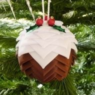 This lovely handmade Christmas pudding Decoration is just perfect for any Christmas tree. It's made from Brown and White ribbon, this is cut to size and pinned onto a 6cm polystyrene ball with small sequin pins. the top is then decorated with Green seq...