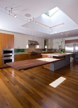 Interesting countertop and skylight. Counter top: Gray part of concrete anchored to the slab, two i beams underneath are anchored to the concrete.