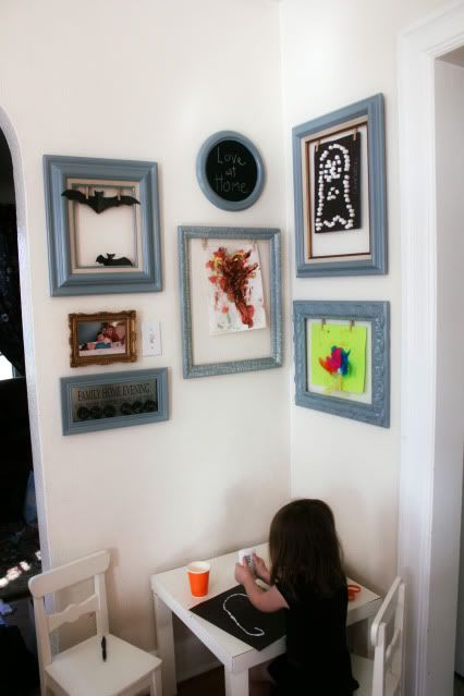 Displaying kid's art - fab idea in vintage cool photo frames!