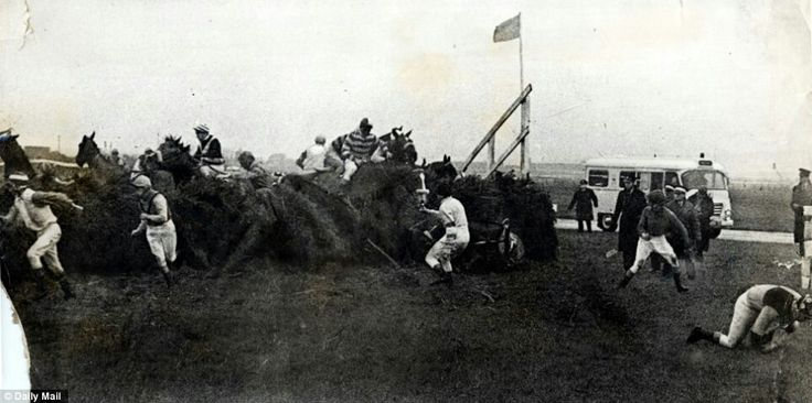 The melee at the 23rd fence allows Fionavon to jump clear alone at win the 1967 Grand National.