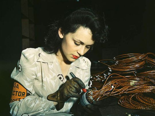 June 1942 (Rare Color Photo)  Woman aircraft worker, Vega Aircraft Corporation, Burbank, Calif. Shown checking electrical assemblies.