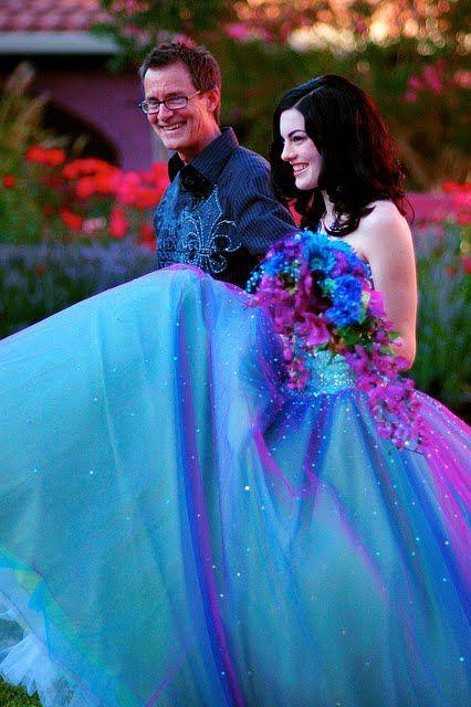 Bride in Rainbow Wedding Dress - http://casualweddingdresses.net/rainbow-wedding-dress-the-ideal-somewhere-over-the-rainbow-wedding-dream/