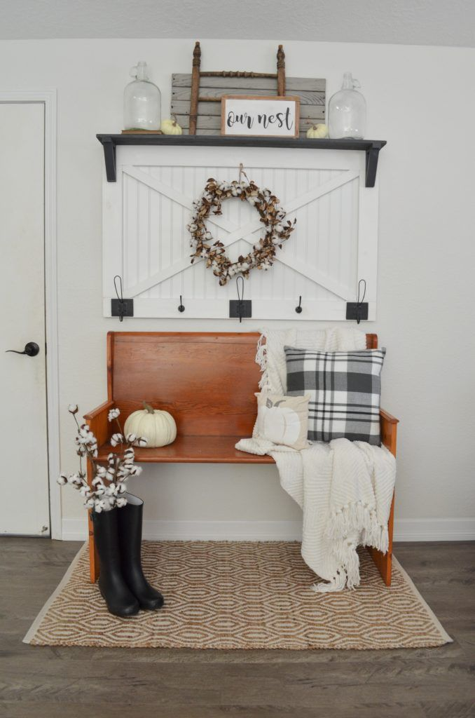 Cozy fall farmhouse entryway. This neutral fall entryway is so cozy and perfect for fall. Plaid, cotton wreath and church pew.
