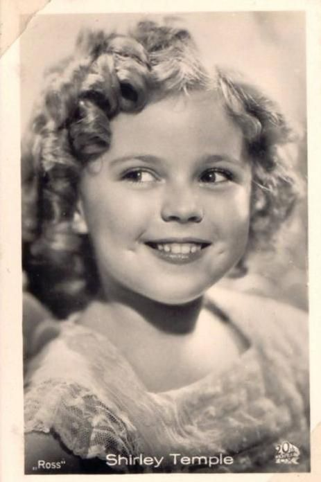 Shirley Temple, 1930s.  I wanted hair just like hers and my grandma was happy to put me in curls and more curls!