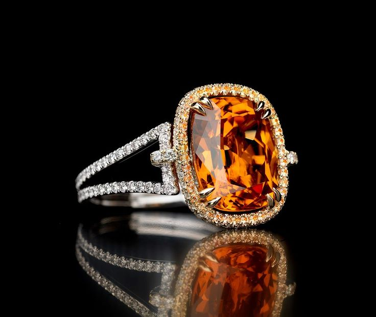 Cushion Cut Mandarin Garnet ring    Delicately and artfully accented with diamonds, yellow and orange sapphires, the 7.66 carat cushion cut Mandarin garnet is stunning in color and simplicity.  http://jaycarlile.com/