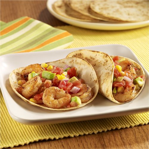 A simple shrimp taco recipe prepared on the grill and topped with a zesty avocado-tomato salsa