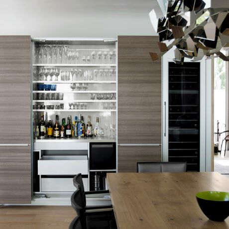 This is an outstanding Poggenpohl customised bar. The sleek exterior opens to reveal well-stocked shelves that add to the shared experience of entertaining.   #Poggenpohl #DecorPrintTeakLava