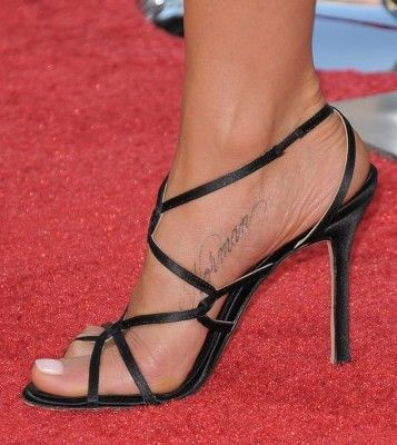 """Jennifer Aniston has her dog's name, """"Norman"""" on her instep - Tattoos.net"""