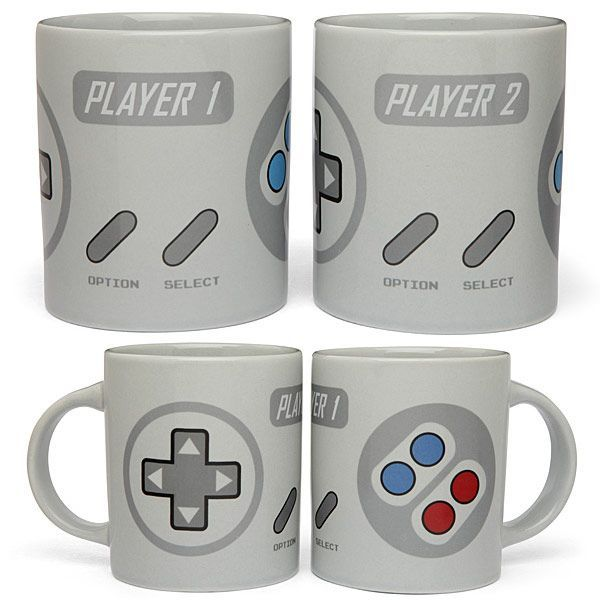 """Gamer couples will love this 2-Player Gaming Mug Set. Apart, you are but two separate areas of the controller, but together, you can beat that high score.  One mug reads """"Player 1"""" & the other reads """"Player 2""""."""