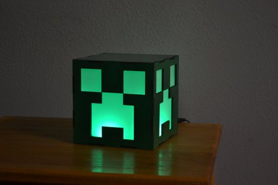 This 4.75x4.75 Creeper face inspired cube lamp will brighten up any room! It is remote controlled and changes not only to green, but also to many other