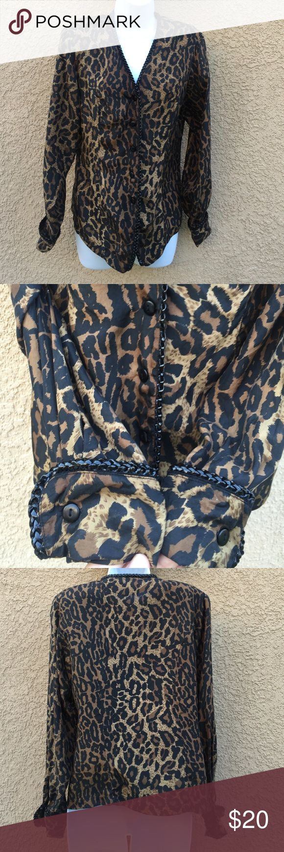 Silk Animal print long sleeve top Gently worn , size S , 100 percent silk , black non leather trim through tour front and sleeves, shoulder pads Anna & Frank  Tops Blouses