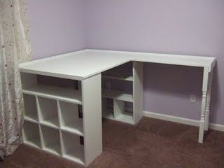 I could use this homemade desk (made of bookcases and table tops)... i can see where my sewing machine could go, beads, buttons, everything has a spot...
