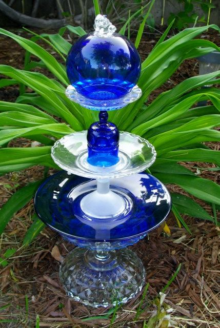 This glass art piece is 20 ins. tall and sits nicely on the ground or on a deck. All the glass is vintage. I choose glass that is chip and crack free but some wear my be present.    Whether it is a special celebration or simple everyday use, Antique Glass Art from  A Blend of Now & Then combines beauty along with functionality to your home, garden or office.    I ship USPS, insured and securely packaged for piece of mind. Any overage in shipping (-) $3.50 for my handling will be reimbursed…