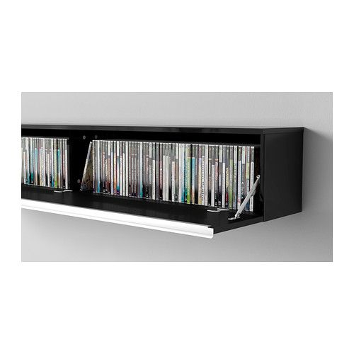 BESTÅ BURS Wall shelf IKEA Holds 118 DVDs. - something like this to put over the back of the sofa as a a display shelf and to contain DVD and game cases. - UPDATE - bought this to go under the big screen at the office, it is rock solid and awesome, holds everything