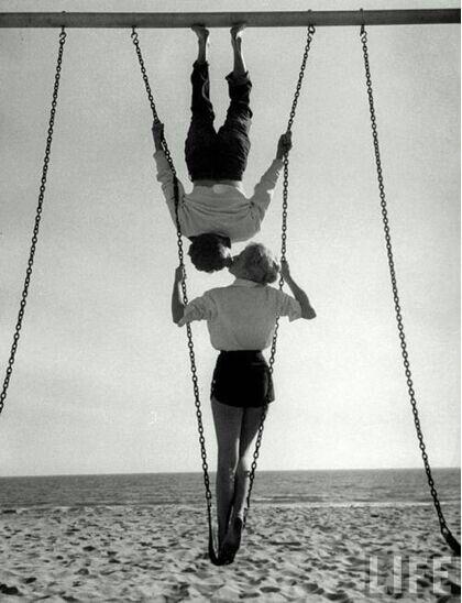 Acrobat and actor, Russ Tamblyn on Venice Beach with movie actress Venetia Stevenson.