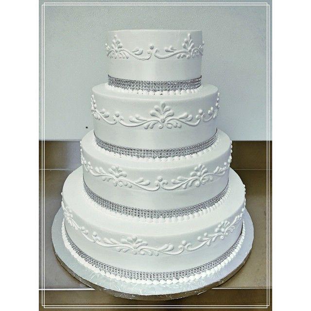 Elegant 4 tier soft cream wedding cake!!! #wedding #cake #bride #groom #love #newbeggings #thebigday #family #reunion #sweettable #weddingcake #celebration #anniversay #eatcake #strawberryshortcake #vanilla #chocolate #realcream #Torontobakery #greekbakery #danforth #eastyork #papevillage #seranobakery #Toronto #bakery
