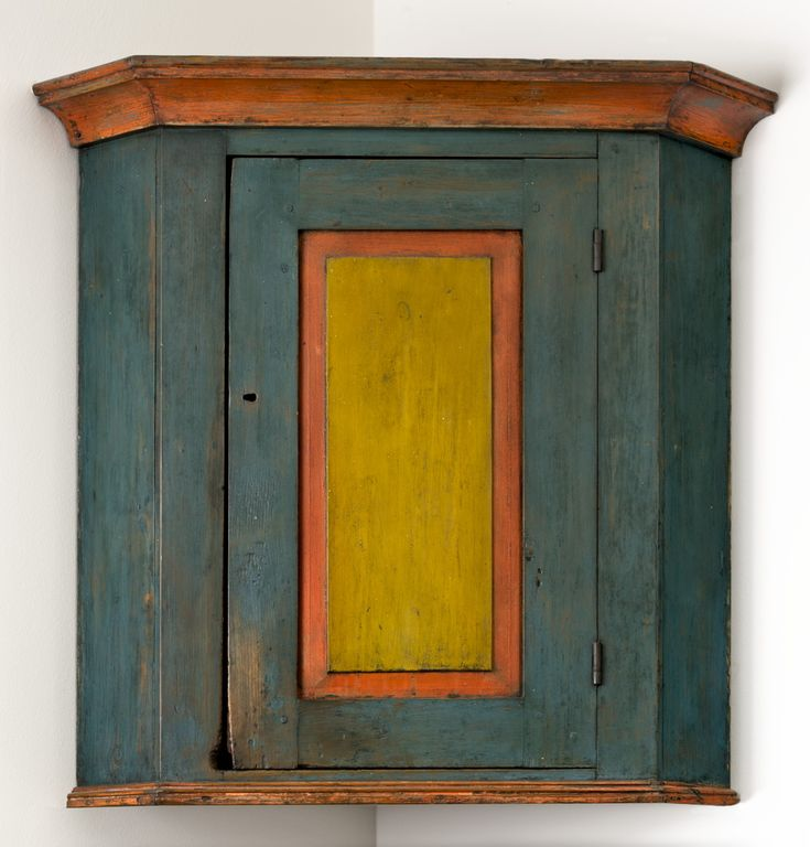 Paint-decorated hanging corner cupboard Pennsylvania, circa 1820 Est. $5,000-$8,000