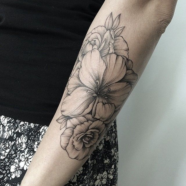 black and grey scale flower tattoo