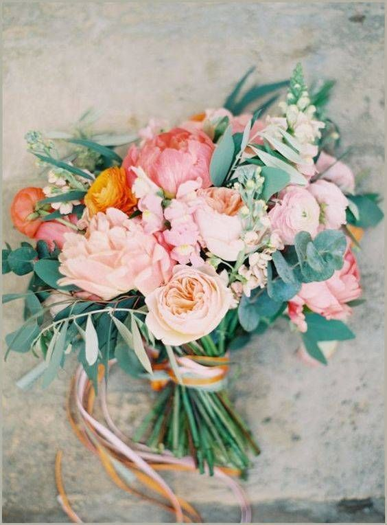 I really like the peach, pink and rose colors paired with the soft gray greens. I also like the size and shape (and proportions) of this bouquet for the bride or MOH flowers. Also love the garden roses and peony. Multiple coordinating ribbons are cute, too.