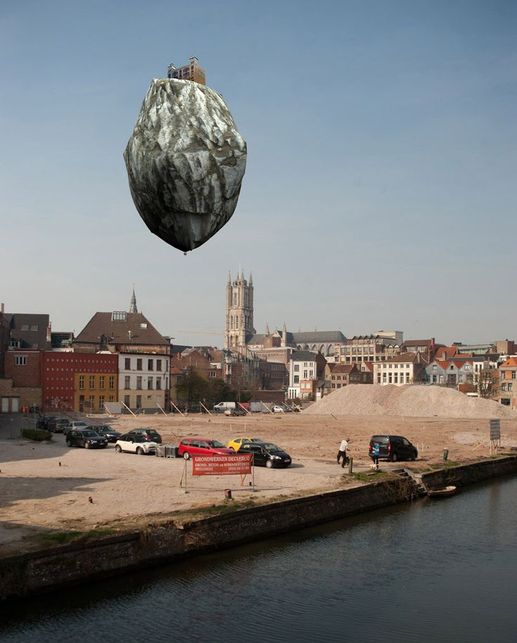 05 /17/ 2012 - Castle of Vooruit by Turkish artist Ahmet Ogut, 2012 at TRACK art festival at Ghent, Belgium / Ogut´s work is a helium-filled balloon floating above the ground at a height of eleven meters and diameter of eight meters. Ahmet Ogut is known for his pseudo-documentary style portfolio which often employs humor while investigating the patterns of social and public movements in urban environments. Ghent's intervention project, TRACK, officially begun May 12th and ends on September…